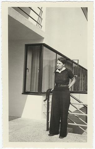Photograph of Bryher leaning against a railing at Kenwin in Vevey, Switzerland ca. 1932. Image from Beinecke Library Digital Collections, Bryher Papers.